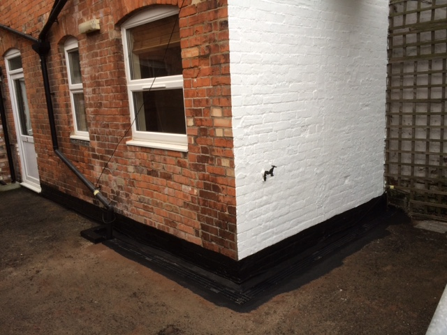 House brick wall after maintenance and painting